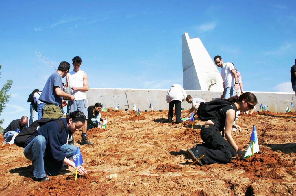 Planting trees on Tu Bishvat at the Lehi Monument, in the Lehi Forest at Moshav Mishmar Ayalon between Latrun and Ramle, central Israel (Shmuel Bar-Am)