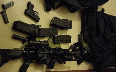 Weapons and ammunition seized by IDF soldiers in the West Bank village of Kfar Itrach, January 11, 2016. (IDF Spokesman)