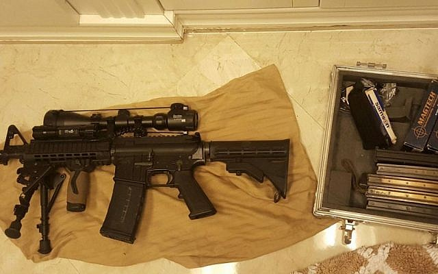 A shortened M-16 assault rifle, with a scope and additional magazines, discovered by IDF forces in the Palestinian city of Tulkarem on January 28, 2016. (IDF Spokesperson's Unti)