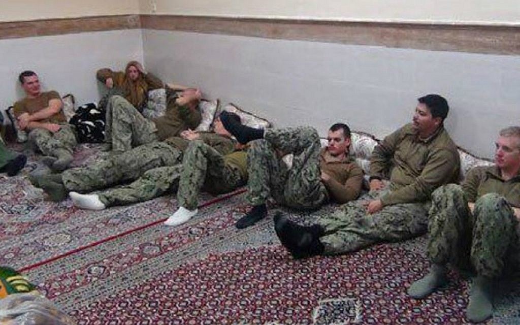 File: US sailors released by Iran on January 13, 2016, after their boats entered Iranian territorial waters the day before. (screen capture/Twitter)