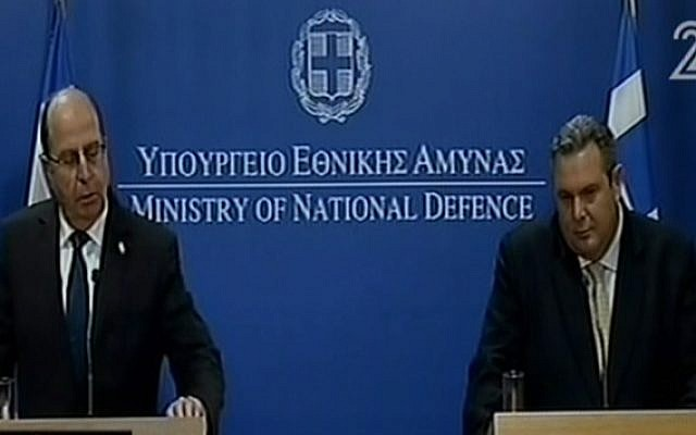 Defense Minister Moshe Ya'alon speaking at a press conference in Athens with Greek counterpart Panos Kamenos on January 26, 2016 (screen capture: Channel 2)