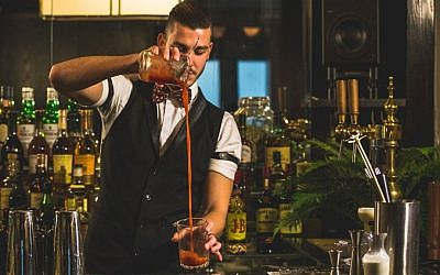 Pouring cocktails at Gatsby in Jerusalem (Courtesy: Koby Sharvit)