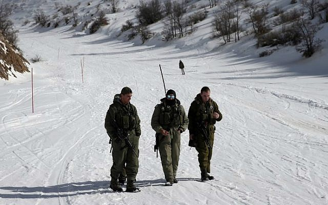 IDF soldiers patrol a slope at the Mount Hermon ski resort, on January 21, 2016. (Thomas Coex/AFP)