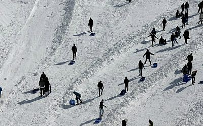 People use sledges at the Mount Hermon ski resort on the Golan Heights, on January 21, 2016. (Thomas Coex/AFP)
