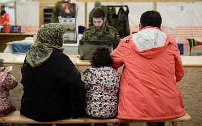 Refugees from Syria wait to register at the German army's air base in Erding, southern Germany, on January 31, 2016. (AFP/dpa/Andreas GEBERT)