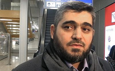 Chief negotiator for the main Syrian opposition body, Mohammed Alloush answer question by AFP TV upon his arrival at Geneva Airport, on February 1, 2016. (AFP / MUMEN KHATIB)