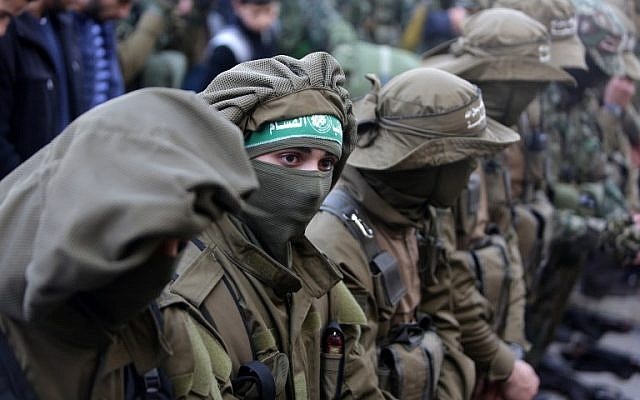 Members of the Izz ad-Din al-Qassam Brigades, the armed wing of the Hamas terrorist movement, mourn during the funeral of fellow militant Ahmed al-Zahar in the village of Al-Moghraga near the Nuseirat refugee camp in the central Gaza Strip on February 3, 2016. Zahar was killed in a tunnel collapse.  (AFP/Mahmud Hams)
