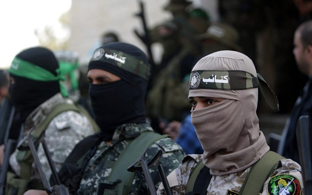 Members of the Izz ad-Din al-Qassam Brigades, the armed wing of the Hamas movement, at the funeral of fellow terrorist Ahmed al-Zahar in the village of Al-Moghraga near the Nuseirat refugee camp in the central Gaza Strip on  February 3, 2016. (AFP/Mahmud Hams)