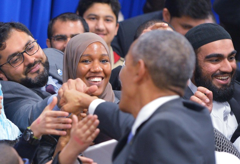 US President Barack Obama greets attendees at the Islamic Society of Baltimore, in Windsor Mill, Maryland, on February 3, 2016. (AFP/MANDEL NGAN)