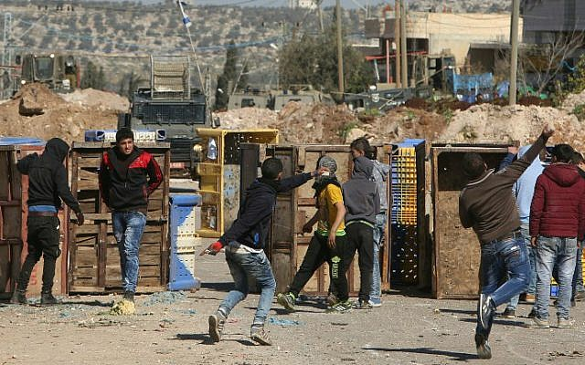 Palestinian youths clash with Israeli security forces in Qabatiya, a town near Jenin in the northern West Bank, on February 4, 2016. (Jaafar Ashtiyeh/AFP)