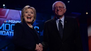 US Democratic presidential candidates Hillary Clinton and Bernie Sanders shake hands before participating in the MSNBC Democratic Candidates Debate at the University of New Hampshire in Durham on February 4, 2016. (AFP/JEWEL SAMAD)