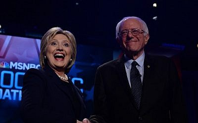 US Democratic presidential candidates Hillary Clinton and Bernie Sanders shake hands before participating in a debate at the University of New Hampshire in Durham, February 4, 2016. (AFP/Jewel Samad)