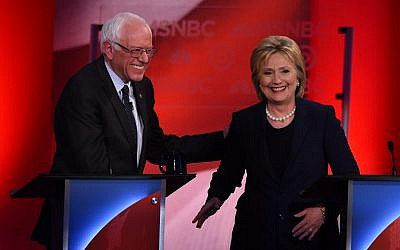 US Democratic presidential candidates Hillary Clinton (R) and Bernie Sanders smile after participating in the MSNBC Democratic Candidates Debate at the University of New Hampshire in Durham on February 4, 2016. (AFP/Jewel Samad)