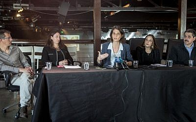 (L to R) Israeli NGO leaders, Hagai El-Ad, Reut Michaeli, Yuli Novak, Tania Hary and Jafar Farah, attend a press conference on February 5, 2016 in Tel Aviv. (AFP/JACK GUEZ)
