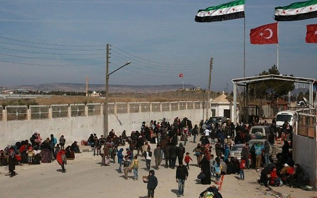 Syrians fleeing the northern embattled city of Aleppo wait at the Bab al-Salama crossing on the border between Syria and Turkey, on February 5, 2016. (AFP / STRINGER)