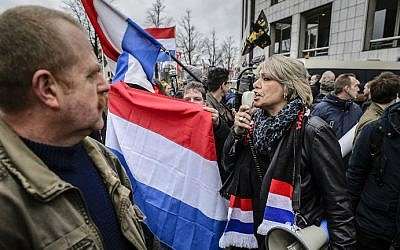 Demonstrators wave national flags of the Netherlands as members of Pegida (Patriotic Europeans Against the Islamization of the Occident) protest in central Amsterdam on February 6, 2016. (Remko De Waal/ANP/AFP)