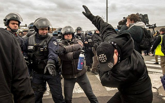 Policemen arrest a supporter of the Pegida (Patriotic Europeans Against the Islamization of the Occident) movement during a demonstration in Calais, northern France on February 6, 2016. (Philippe Huguen/AFP)