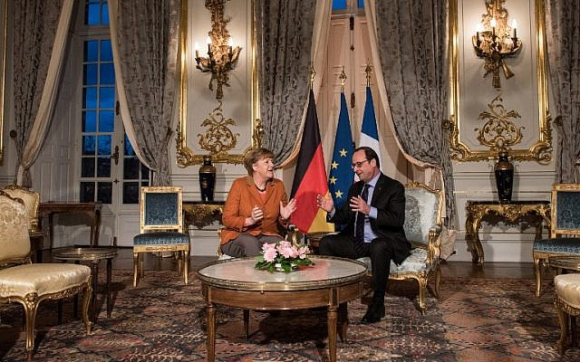French President Francois Hollande (R) and German Chancellor Angela Merkel talk together at the Prefecture in Strasbourg, eastern France, on February 7, 2016, during a meeting about the migrant crisis. (AFP/Pool/Patrick Seeger)