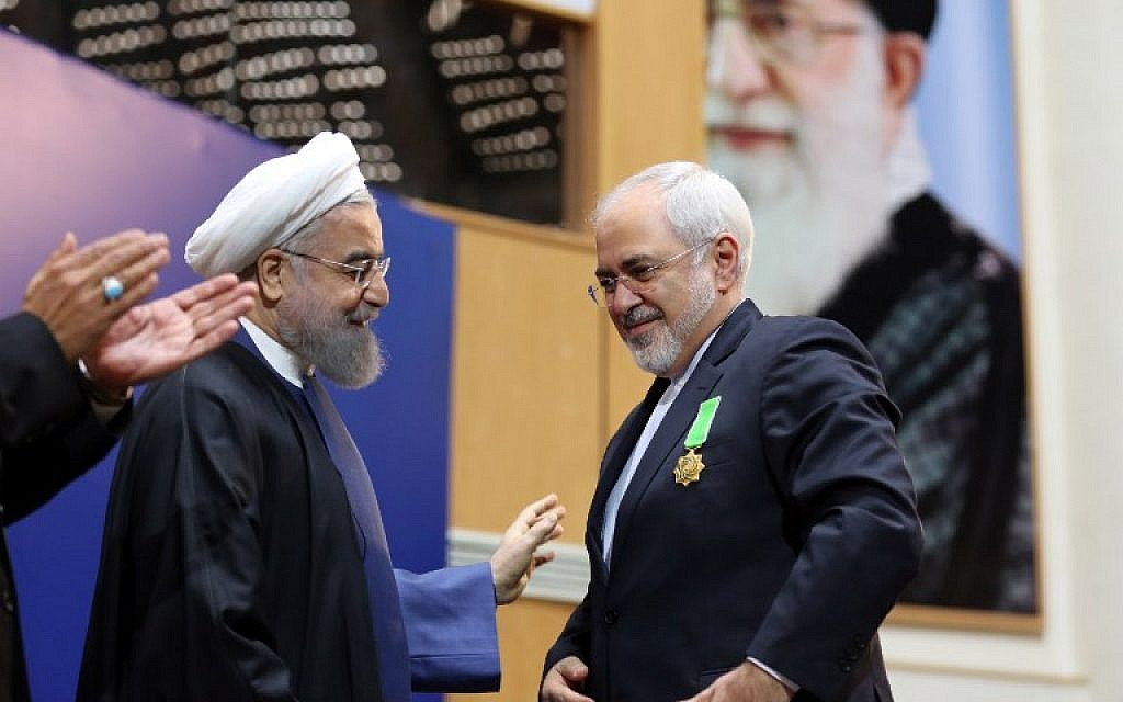 File: Iranian President Hassan Rouhani, left, awards Foreign Minister Mohammad Javad Zarif with the Medal of Honor for his role in the implementation of a nuclear deal with world powers, on February 8, 2016, in Tehran. (AFP / ATTA KENARE)