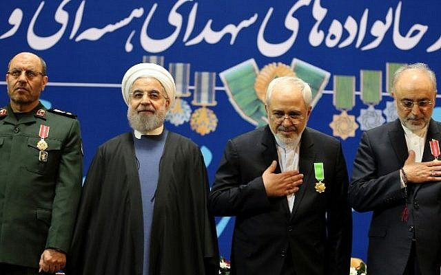 Iran's Defense Minister Hossein Dehghan (L), Foreign Minister Mohammad Javad Zarif (2nd from R) and Ali Akbar Salehi (R), the head of Iran's Atomic Energy Organization, pose for pictures after receiving the Medal of Honor from President Hassan Rouhani (2nd from L) for their role in the implementation of a nuclear deal with world powers, on February 8, 2016, in Tehran. (Atta Kenare/AFP)