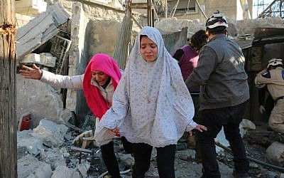Syrian girls react following a reported Syrian regime air strike in a rebel-controlled area in the northern city of Aleppo on February 8, 2016. AFP / Ameer al-Halbi)