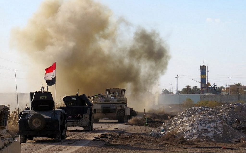 Iraqi pro-governement forces drive their armoured vehicles in the Jwaibah area, on the eastern outskirts of Ramadi, on February 8, 2016, after they retook the region from Islamic State (IS) group jihadists (AFP/MOADH AL-DULAIMI)