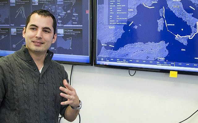 Israeli Ami Daniel, CEO and co-founder of the Windward company speaks in front of a screen as he poses at the company's offices on February 9, 2016 in the Israeli city of Tel Aviv. (Jack Guez/AFP)
