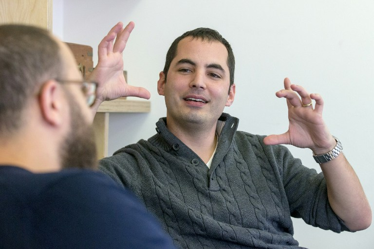 Israeli Ami Daniel, right, CEO and co-founder of the Windward company talks with co-founder Matan Peled at the company's offices on February 9, 2016 in the Israeli city of Tel Aviv. (Jack Guez/AFP)