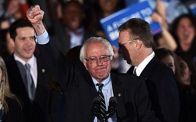 US Democratic presidential candidate Bernie Sanders celebrates his victory during the primary night rally in Concord, New Hampshire, on February 9, 2016. (AFP/Jewel Samad)