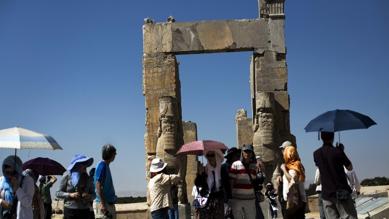 "Chinese tourists from Hong Kong visiting the ""Gate of All Nations"" at the ancient Persian city of Persepolis near Shiraz in southern Iran, September 26, 2014 (AFP / BEHROUZ MEHRI)"