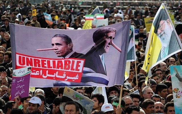 Iranians hold an anti-US slogan during celebrations in Tehran's Azadi Square (Freedom Square) to mark the 37th anniversary of the Islamic revolution on February 11, 2016. Posters depict President Obama and Secretary Kerry with Pinocchio-style liars' noses, and the text 'Unreliable' (Atta Kenare/AFP)