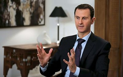 Syrian President Bashar Assad gestures during an interview in the capital Damascus on February 11, 2016. (AFP/Joseph Eid)