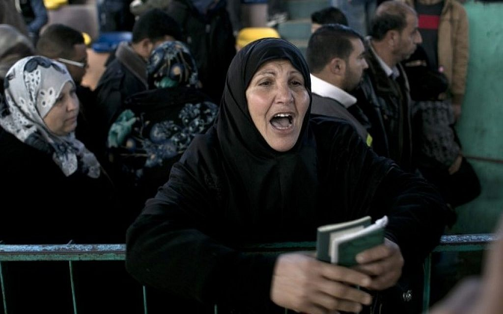 Palestinians await permission to enter Egypt as they gather at the Rafah Border Crossing in the southern Gaza Strip, on February 14, 2016. (AFP/Said Khatib)