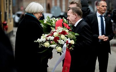 Danish Prime Minister Lars Lokke Rasmussen (R) and Mayor of Copenhagen Frank Jensen (hidden) are speaking to Bodil Uzan (L), the mother of Dan Uzan who was killed while working as a security guard at the synagoge, during a commemoration in Copenhagen February 14, 2016. (AFP / Scanpix / Liselotte SABROE / Denmark OUT)