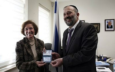 German Nazi-hunter Beate Klarsfeld (L) receives her new Israeli passport and ID from Interior Minister Aryeh Deri during a ceremony at the Interior Ministry in Jerusalem, February 15, 2016. (Thomas Coex/AFP)