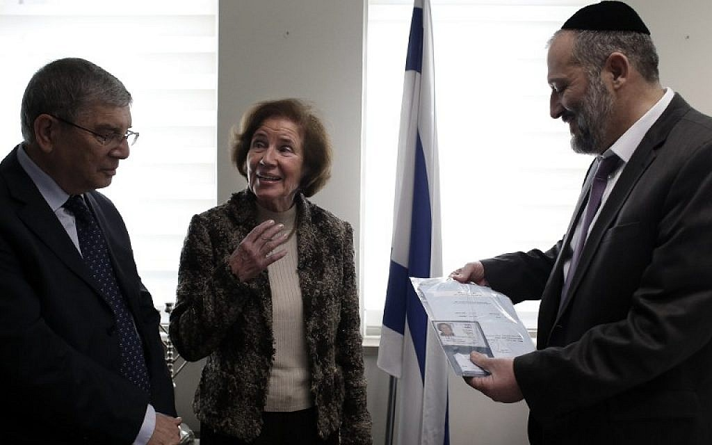 German Nazi-hunter Beate Klarsfeld, center, receives her Israeli ID from Interior Minister Aryeh Deri, right, Yad Vashem head Avraham Shalev in Jerusalem on February 15, 2016. (AFP / THOMAS COEX)