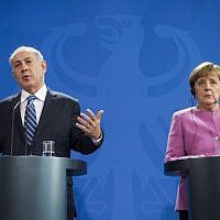 German Chancellor Angela Merkel, right, and Prime Minister Benjamin Netanyahu speak at a press conference at the Chancellery in Berlin, on February 16, 2016, after a joint cabinet meeting. (AFP /Odd Andersen)