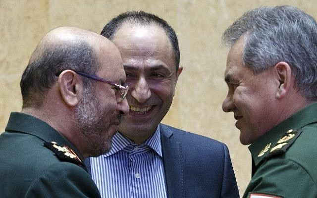 Russian Defense Minister Sergei Shoigu (R) and Iranian Defense Minister Hossein Dehghan (L) shake hands during their meeting in Moscow, Russia, on February 16, 2016 (AFP / POOL / VADIM SAVITSKY)