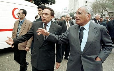 This file photo taken on February 6, 1999 shows Egyptian journalist Mohammad Hassenin Heikal (R) and comedian Adel Imam attending the funeral of Egyptian writer Lotfi al-Kholi, a leading promoter of peace with Israel. (AFP / AMR NABIL)