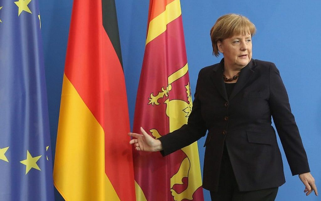 German chancellor Angela Merkel leaves a  press conference at the Chancellery in Berlin on February 17, 2016.  (AFP / Adam BERRY)