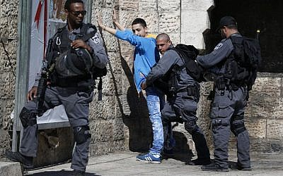 Illustrative. Border police check a Palestinian at Damascus Gate in the Old City of Jerusalem on February 17, 2016. (AFP / AHMAD GHARABLI)