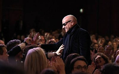 "Italian director Gianfranco Rosi reacts on his way to the stage to receive the Golden Bear for Best Film for the film ""Fuocoammare"" (Fire at Sea) during the awards ceremony of the 66th Berlinale, Europe's first major film festival of the year, on February 20, 2016 in Berlin. (Tobias Schwarz/AFP)"