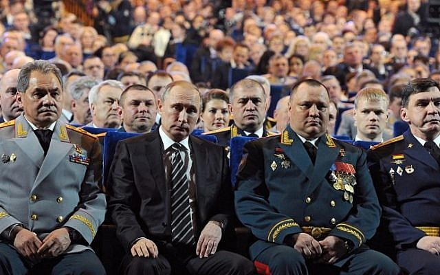 Russia's Minister of Defense Sergei Shoigu, left, and Russia's President Vladimir Putin, 2nd left, attend a gala at the State Kremlin Palace in Moscow on February 20, 2016. (AFP / MIKHAIL KLIMENTYEV)