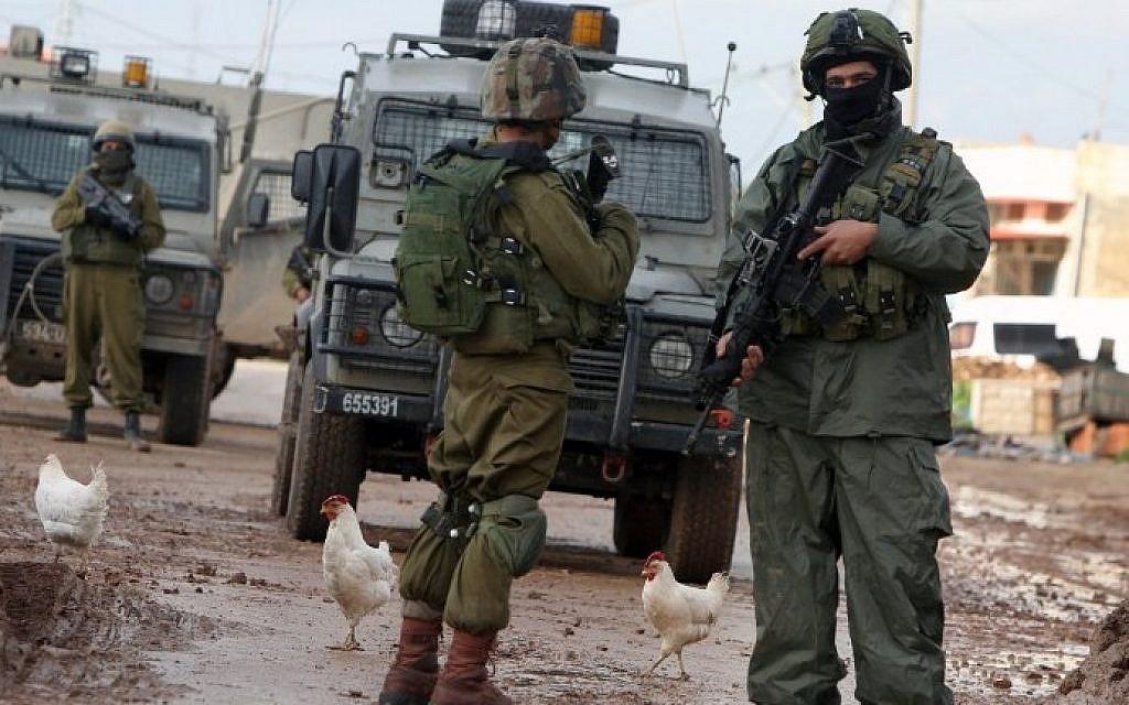 Illustrative photo of Israeli soldiers in the West Bank on February 22, 2016. (AFP/JAAFAR ASHTIYEH)