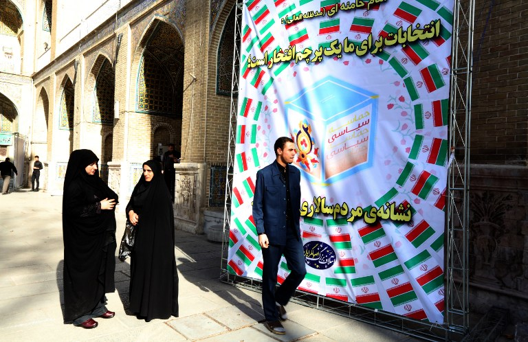 Iranians stand outside a meeting of Iran's main conservative parties, ahead of the upcoming parliamentary elections, on February 23, 2016 at Motahari mosque in Tehran. (AFP / ATTA KENARE)
