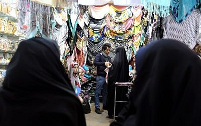 Iranian women shop for scarves at the ancient Grand Bazaar of the holy city of Qom, 130 kilometers south of Tehran, on February 24, 2016. (AFP / ATTA KENARE)