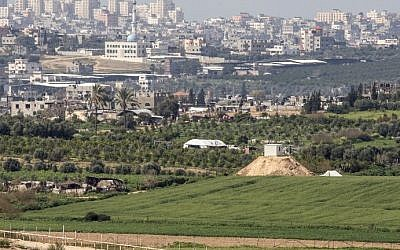 File: A photo taken from the Israeli side of the border with the Gaza Strip shows a Hamas outpost on a hill (right) along the border, February 25, 2016. (AFP/Jack Guez)