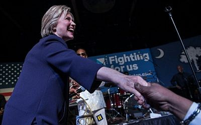 US Democratic presidential candidate Hillary Clinton shakes hands after making an appearance on stage at the Music Farm in Charleston, South Carolina, on February 25, 2016 during a concert by singer Charlie Wilson. (AFP / Nicholas Kamm)
