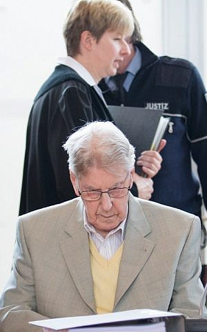 Judge Anke Grudda walks behind the defendant, former Auschwitz guard Reinhold Hanning in court for the continuation of his trial at the court in Detmold, western Germany, on February 26, 2016. (Friso Gentsch/Pool/AFP)