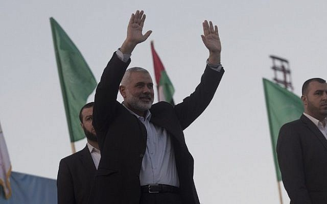 Hamas chief Ismail Haniyeh waves to the crowd during an anti-Israel rally on February 26, 2016, in the southern Gaza Strip town of Rafah. (AFP/Said Khatib)
